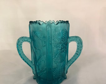 Beautiful L G Wright Handled Vase in the Paneled Thistle pattern.  Has the old Wright Bee marked.  (CGP-3233)