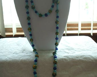 """Vintage Glass and other Medium 60"""" long Costume Necklace."""