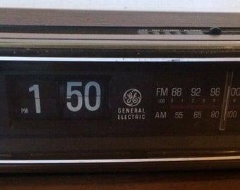 1970's Vintage General Electric Flip Clock Wood Grain Alarm Radio AM/FM GE Model No. 704305B Walnut Grain Finish on Polystyrene Woodgrain