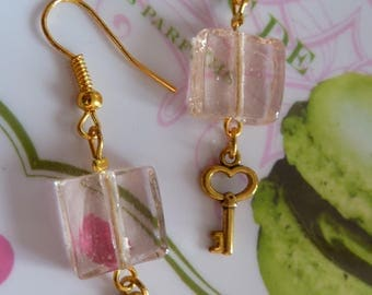 Gold metal key to happiness and translucent pink square bead earrings