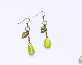 Bronze dangle earrings adorned with green beads and a charm feather