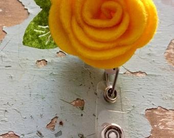 Yellow rose flower ID badge reel holder retractable clip