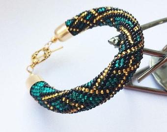 Emerald beaded crochet bracelet Kelt jewelry Golden lines on green Tube bracelet Green bracelet  Handmade jewelry Gift for women