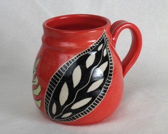 Pottery mug in a beautiful red and black leaf design
