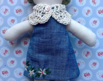 Cloth doll with blue dress