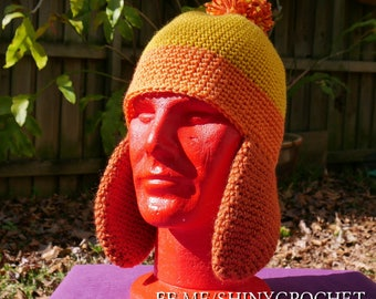 Jayne's Cunning Hat - shiny crochet beanie with pom and earflaps in orange and yellow