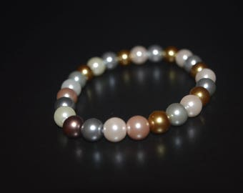 Gold, Pink and White Bracelet