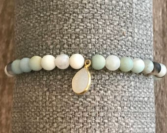 Matte turquoise amazonite bracelet with pink geode charm
