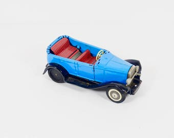 Vintage Metal Toy Car Sign of Quality Japan Antique Pressed Tin Toy Car Jalopy