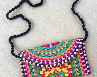 The Neon Aztec Clutch Bag, Small. A one of a kind handmade embroidered Indian bag with PomPom strap.