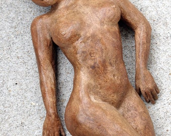 Young nude woman lying clay sculpture fired patina