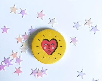 Heart face pin badge