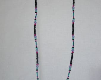Black, pink, teal, and purple beaded necklace