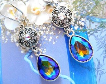 Vintage dangling silver and Blue Crystal drop earrings.