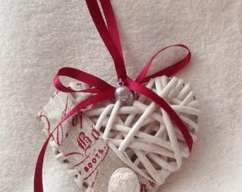 Wicker hanging heart decorated linen and a cameo