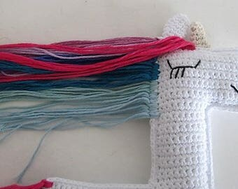 Unicorn blanket hand crocheted with soft colors