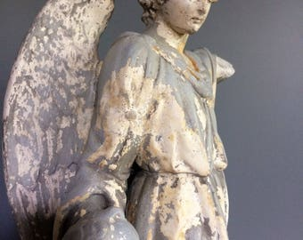 Antique statue of an Angel plaster with child.