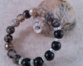 Gemstone bracelet with onyx and agate beads as well as Strassrondelle