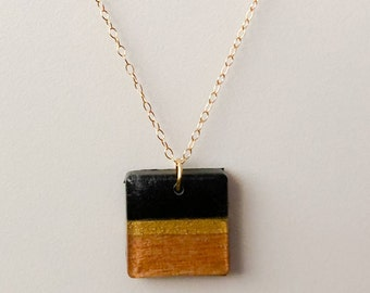 Resin wood pendant on a gold filled chain