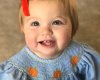 Hand tied vintage velvet baby bow clip or nylon headband in pumpkin orange