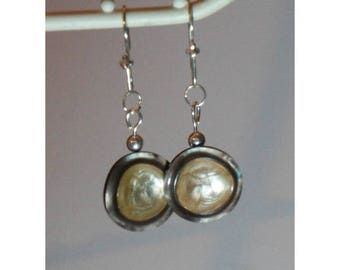 Earrings and her mother of Pearl buttons