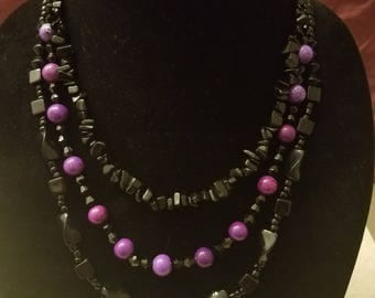 Handmade multi-strand necklace with black and purple beads