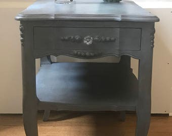 Beautiful side table with carved rosette detail