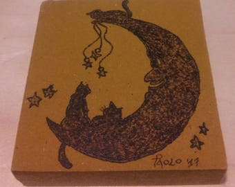 Hand burning with Moon and cats