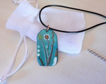 Pendant Necklace with enamel, flowers, water green speckled opaque enamel and touch of orange, yellow and white, black cord.