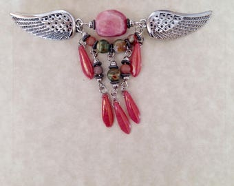 This Winged Sweater Clip doesn't stop there. Tighten a top or a tee. Use as a Shawl Clip. Clip anywhere for color and interest.