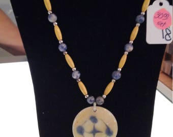 Blue-Lapis, hairpin bone, metal beads, and bone bucklet necklace