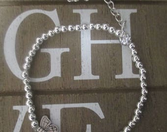 silver tone 4mm beaded bracelet with silver chain detail and butterfly elements