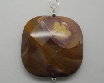 Faceted Mookite Jasper and sterling pendant  this is a large stone