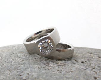 Wide band engagement ring and matching wedding band, alternative cushion cut engagement ring, bezel set moissanite, wide hammered band