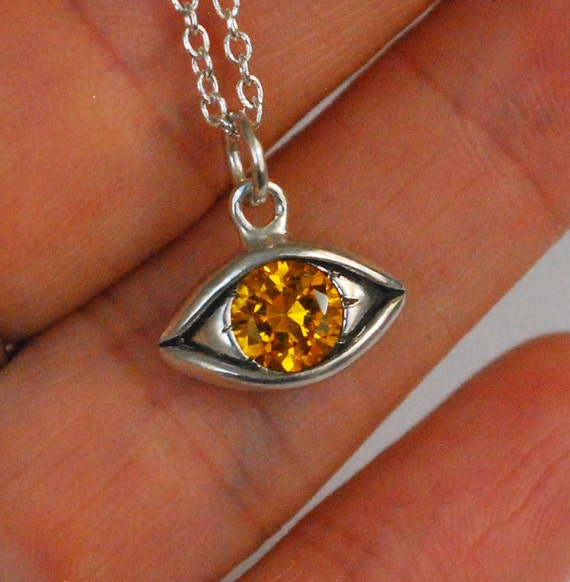 Large Sterling Silver and Golden Eye Charm