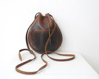 70s vintage handmade leather pouch. small leather bag. crossbody purse. medicine bag