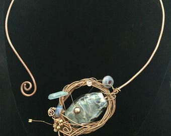 Statment neck cuff with glass, pearl, guitar string, and crystal