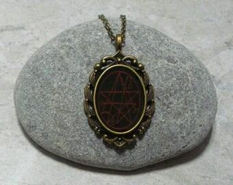 Necronomicon Necklace Pendant Antique Bronze Black Red