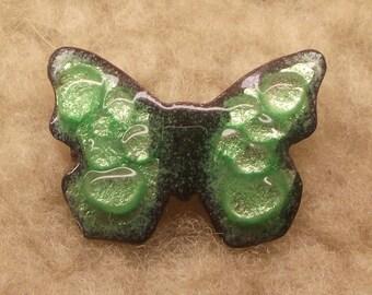 Brooch butterfly, light green glaze, gray background