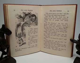 First Edition, thus Alice's Adventures in Wonderland by Lewis Carroll - Macmillan, 1922 Miniature Edition Hardcover Book