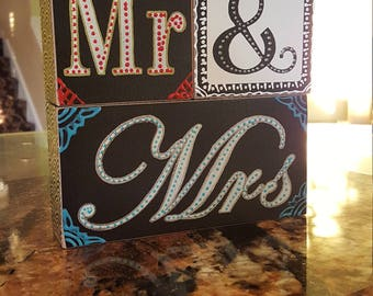 Henna designs on Mr and Mrs sign