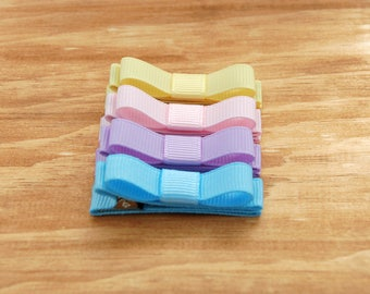 Toddler , baby , girls tuxedo bow barrette in light yellow, pink, purple , and blue grosgrain fully lined on a double prong alligator clip