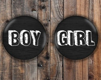 Black and white boy and girl gender reveal pins.