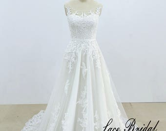 A line wedding dress Lace wedding dress with scoop neckline Gorgeous lace bridal gown
