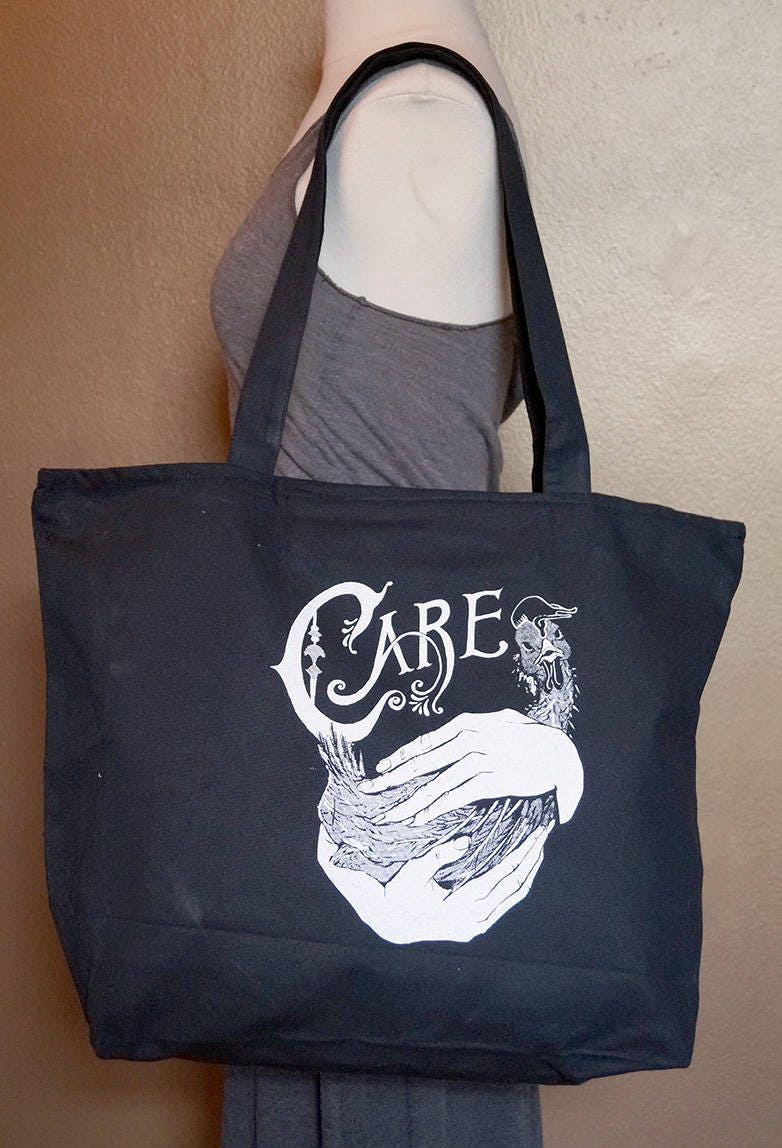 "Zippered Tote Bag ""Care"" White Ink on Black Cotton"