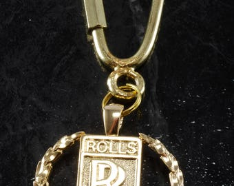 Rolls royce etsy vintage 1980s gold plated metal rolls royce collectible emblem key chain new old stock aloadofball Choice Image