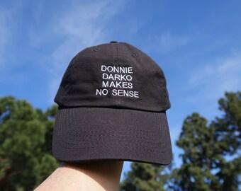 Black Dad Cap Donnie Darko Makes No Sense Low Profile Hat **Free Domestic Shipping**