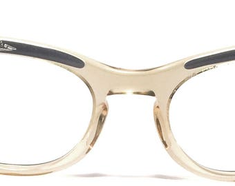 Vintage eyewear. Cat eye style. Made in USA 1950's. Soft gray color. Artistic detailing with rhinestones on front and sides. Excellent!