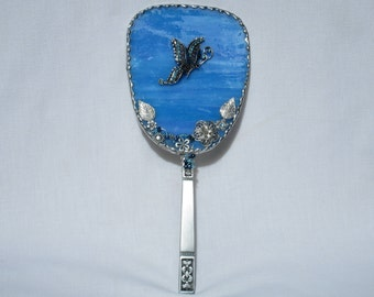hand held stained glass mirror with butterfly