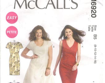 McCall's 6920 Size 8, 10, 12, 14, 16 Women's sewing pattern: V-neck or round neck dress with shoulder princess seams. Flared or pencil style